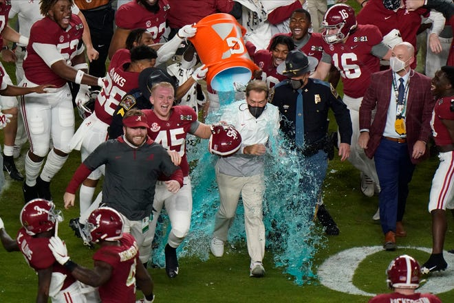 Alabama head coach Nick Saban is soaked in a sports drink after their win against Ohio State in an NCAA College Football Playoff national championship game, Monday, Jan. 11, 2021, in Miami Gardens, Fla. Alabama won 52-24.