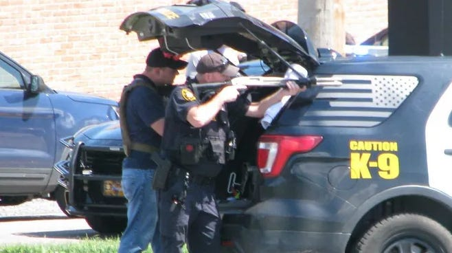 Area law enforcement officers train their weapons on the Chessie Federal Credit Union as a Keyser woman held five hostages inside in an incident that occurred in August 2020.