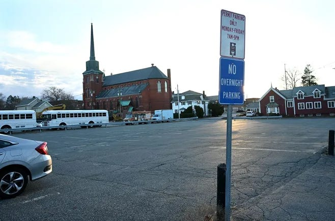 South Avenue commuter parking lot in Natick. The town agreed to a one-year extension to lease the lot from the Archdiocese of Boston.