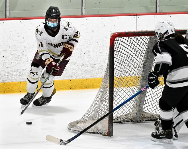 Algonquin's Kerryn O'Connell maneuvers behind the Longmeadow net moments before scoring a goal  during the first period at New England Sports Center in Marlborough, Jan. 13, 2021.