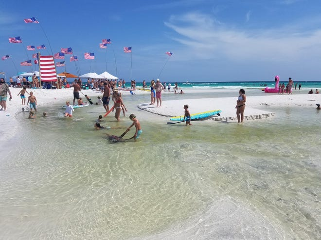 Crowds enjoy a Fourth of July holiday at Grayton Beach, a popular spot for tourists and locals alike along Walton County Road 30A. The county is moving to possibly acquire property for a public restroom to be located near the beach.