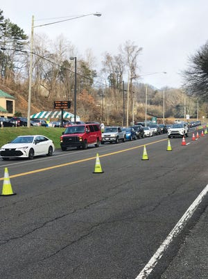 The line of vehicles containing people seeking the free COVID-19 tests at the Anderson County Health Department wound through the parking lot and up the hill on Main Street in Clinton Tuesday morning. The free drive-through tests, administered under the striped tent, are now done only on Tuesday and Thursdays, 8 a.m. to noon. Testing can still be done on Mondays, Wednesdays and Fridays, but by appointment only. The Health Department is now giving the COVID-19 vaccine shots to people age 75 and over, by appointment also.