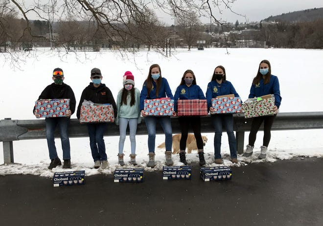 Students from the Hamilton Central School pose Jan. 13 with some of the 27 Thank-A-Farmer baskets and cases of yogurt they delivered to area farm friends.