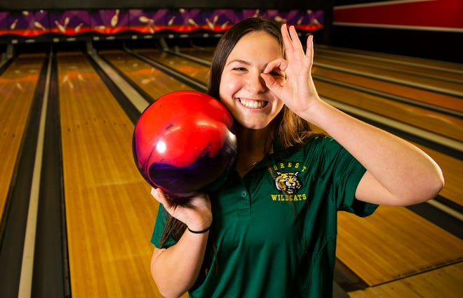 Forest senior Claire Noble shows her three-finger salute to signify her third straight year to earn Bowler of the Year honors.