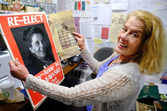 York Town Clerk Mary-Anne Szeniawski holds a reelection poster from 1991 and a Portsmouth Herald clipping from 2004 after she was named the 2019 recipient of the Lorraine M. Fleury Award given annually by the Maine Secretary of State.