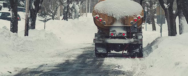 A home heating oil delivery on a snowy day.