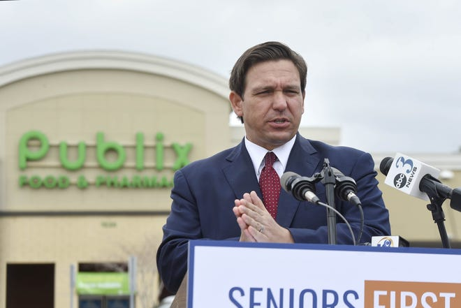 Florida Gov. Ron DeSantis speaks during a news conference Tuesday,  Jan. 12, 2021 at the Publix in Niceville, Fla.   DeSantis announced a partnership with the grocery store chain to begin offering COVID-19 vaccinations to people 65 years and older in Escambia, Santa Rosa and Okaloosa counties. (Devon Ravine/Northwest Florida Daily News via AP)