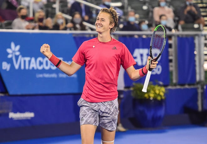 Sebastian Korda celebrates his 6-3, 7-5 victory over Cameron Norrie in the semifinals of the Delray Beach Open at the Delray Beach Stadium and Tennis Center on Tuesday, Jan. 12, 2021.
