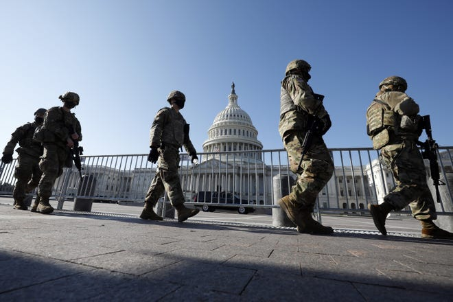 Members of the National Guard arrive on Capitol Hill during the Impeachment debate and vote in Washington on Wednesday.