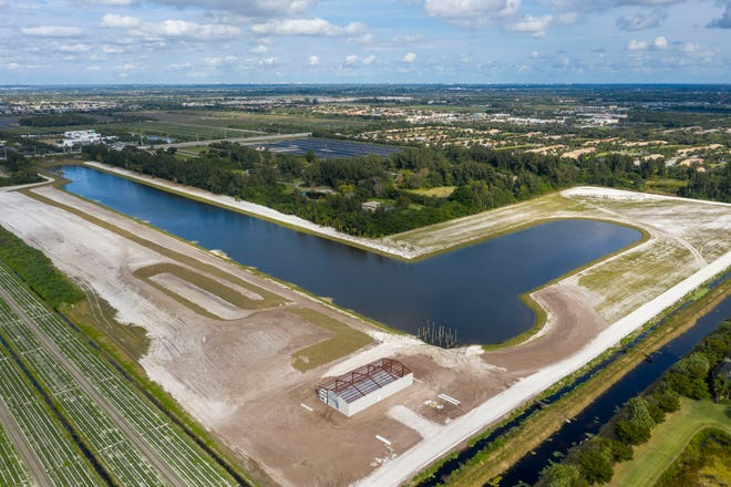 A view Monday of a large lake that was built without permits south of Boynton Beach Boulevard and west of Lyons Road.