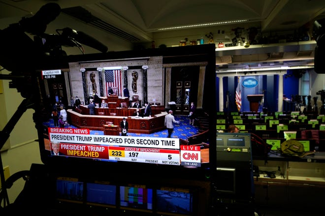 Network monitors inside the White House briefing room display the impeachment proceedings at the U.S. Capitol against President Donald Trump last week.
