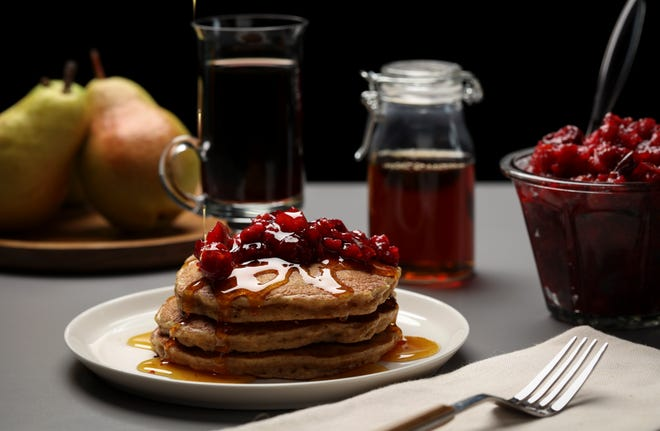 Pancakes with homemade jam can bring the weekend brunch experience home.