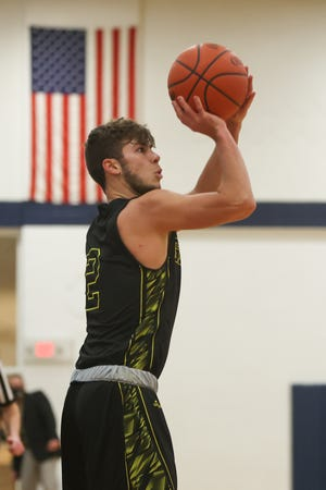 Garfield senior Trystan Gedeon lines up a three-pointer during Tuesday night's game against the Rovers at Rootstown High School.