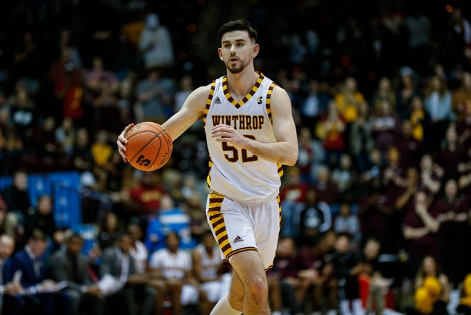 Winthrop guard Chandler Vaudrin brings the ball up court against Hampton in the first half of the Big South tournament championship in Rock Hill, S.C., Sunday, March 8, 2020. (AP Photo/Nell Redmond)