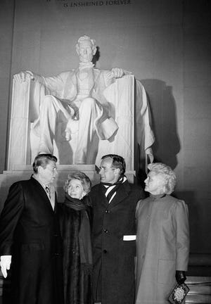 President-elect Ronald Reagan and his wife, Nancy, and Vice President-elect George Bush and his wife, Barbara, stand at the top of the steps of the Lincoln Memorial in Washington on Jan. 17, 1981. A ceremony officially beginning inaugural events was at the Memorial.