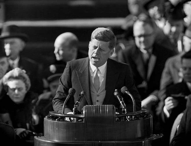 """President John F. Kennedy delivers his inaugural address at Capitol Hill on Jan. 20, 1961, after taking the oath of office. That rallying cry from his inaugural address -- """"Ask not what your country can do for you; ask what you can do for your country"""" -- is etched both in stone and in the minds of generations of Americans."""