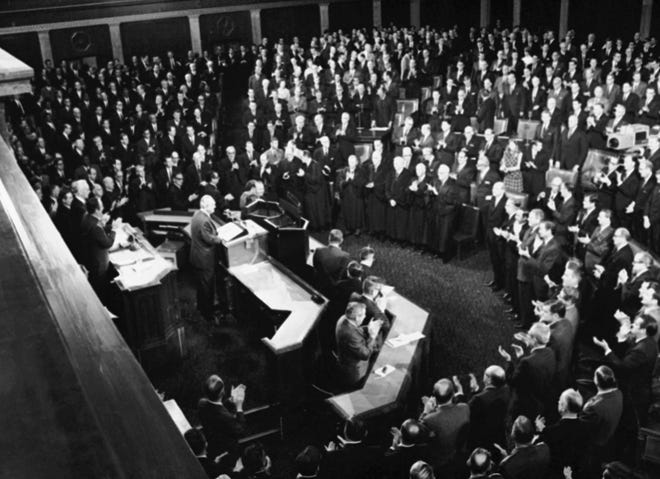 President Lyndon Johnson is applauded by a Joint Session of Congress as he begins his State of the Union address Jan. 14, 1969. Behind him are House Speaker John McCormack and Vice President Hubert Humphrey.  Members of the Supreme Court are in the first row.