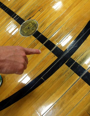 Areas of splitting wood make game play difficult for athletes who use the Crest High School gym.