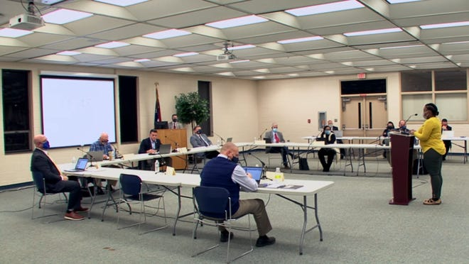 A speaker addresses the county board of education on Monday during a marathon public comment portion of the meeting.