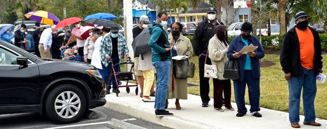 People line up for their COVID-19 vaccination appointments Jan. 13 at the Sarasota Memorial Internal Medicine building in Newtown.