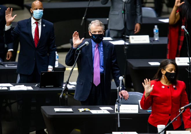 Illinois state Rep. Michael Madigan, D-Chicago, joins lawmakers at their desks on Jan. 13 as they are sworn in for the 102nd General Assembly in the Illinois House of Representatives at the Bank of Springfield Center in Springfield.