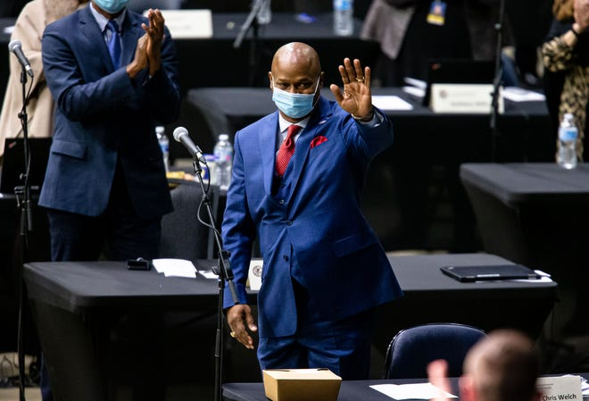 "Illinois State Rep. Emanuel ""Chris"" Welch, D-Hillside, waves as he gets a standing ovation after being elected the Illinois Speaker of the House for the 102nd General Assembly for the Illinois House of Representatives at the Bank of Springfield Center, Wednesday, January 13, 2021, in Springfield, Ill. [Justin L. Fowler/The State Journal-Register]"