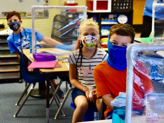 Local students wear masks at school to help prevent the spread of coronavirus.  FILE/PROVIDED