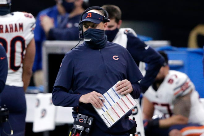Chicago Bears head coach Matt Nagy walks on the sideline of an NFL wild-card playoff football game against the New Orleans Saints on Sunday, Jan. 10, 2021.