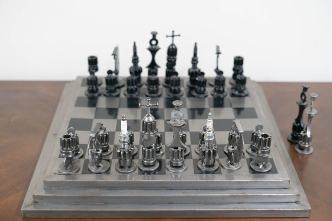 Habitat for Humanity's ReStore InStore Silent Auction for the month of January will feature some unusual items, such as a custom-made chess set built with spark plugs and other car parts. [CONTRIBUTED]