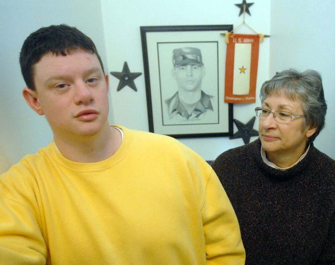 Claudia Hoskins with her son Sean Hoskins with a drawing of Spc. Christopher Hoskins at their home in Danielson. Claudia lost her son Spc. Christopher Hoskins in Iraq in 2005.  [Bulletin file photo March 19, 2013]