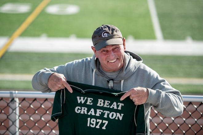 Northboro football coach Ken LaChapelle displays his infamous T-shirt at Lasell Field.