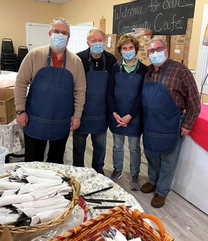 Clinton Exchange Club members helping recently at the WHEAT Community Cafe are (from left) Marty Reisner, Roberta Duvarney, Ed Verrier and Jerry Paen.