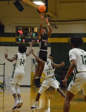 South View guard Cedavion Wimbley (10) scored a game-high 29 points in the Tigers' 69-68 win at Pine Forest on Tuesday night.