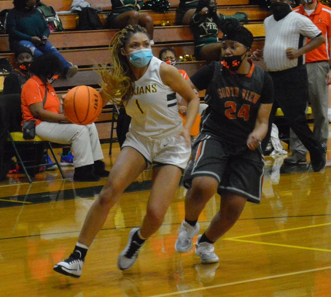 A senior leader for the Pine Forest girls' basketball team, Montasia Jones (1) believes the Trojans have the potential to be champions in 2021.