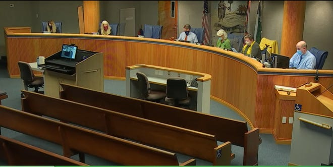 Alachua County commissioners meet in the commission auditorium Tuesday. (Screenshot by Emily Mavrakis)