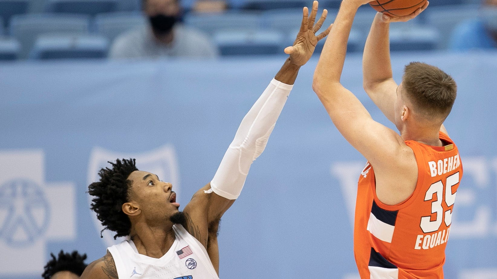North Carolina's Leaky Black challenges the shot attempt of Syracuse's Buddy Boeheim, right, on Tuesday night.