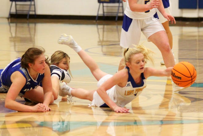 Cedarville point guard Chloe Morrow, right, and Paris guard Rachel O'Neal battle for a loose ball late in the first period Tuesday night at Cedarville, Tuesday, Jan. 12, 2021.