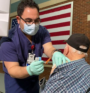Veterans receive COVID-19 vaccines at the VA Medical Center in Tuscaloosa Wednesday, Jan. 13, 2021. RN Phillip Pedram gives the vaccination to Navy veteran Robert Love.