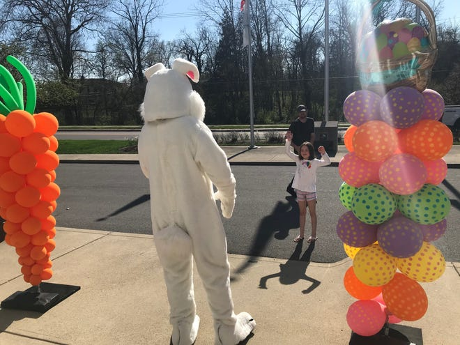 This year's Breakfast with the Bunny, which had been slated for March 27, has been canceled due to the ongoing COVID-19 pandemic. This photo shows Scarlet Armstrong of Pickerington, flanked by her father, Jon Armstrong, waving to the Easter Bunny outside Pickerington City Hall on April 8, 2020, after last year's event was canceled.