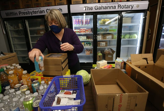 Volunteer Debbie Ballinger sorts food at Gahanna Residents In Need, 165 Granville St., on Jan. 13. GRIN has been so busy that it is looking to hire a food-pantry manager.