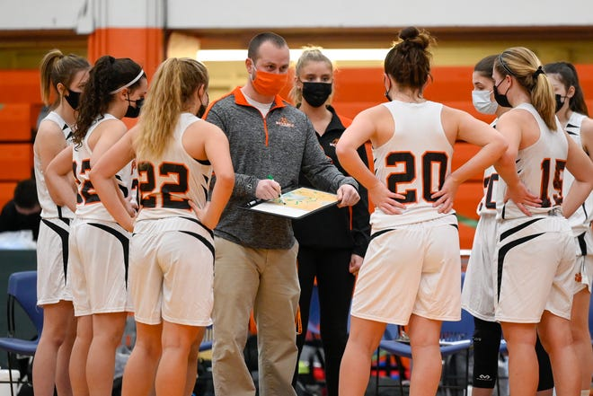 Beverly girls basketball coach Seth Stantial speaks to his team during a timeout in a game versus Winthrop at Beverly High School on Tuesday, Jan. 12.