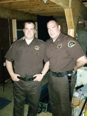 """Scott Galbraith (left) of Weymouth and Xander Steel portray law enforcement officers  in,  """"Murder of Innocence,"""" a film with a Christian theme which is based on the murders of an elderly couple in Washington state in 1971"""