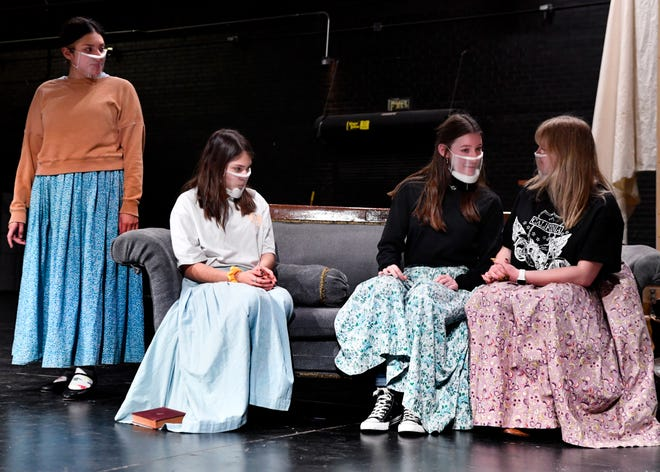 "From left, March sisters Jo (Mia Flores), Beth (Bradie Flores) and Meg (Karissa Ward) converse with their mother Marmee (Leann Bailey) - masked up even though it's the mid-19th century, in this rehearsal scene from Abilene High School's production of ""Little Women,"" which opens next week."