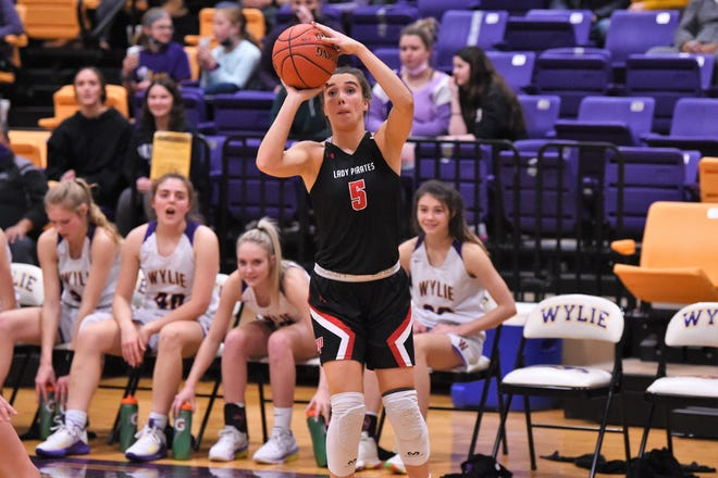 Lubbock-Cooper's Avrie Douglas (5) puts up a shot during the Lady Pirates' 52-49 victory Tuesday at Abilene Wylie. Cooper won on a 3-point goal in the final seconds.