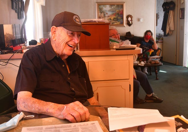 COVID-19 survivor Jim Rowsey, 89, laughs at his kitchen table inside his Cape Canaveral home. He spent Christmas at Cape Canaveral Hospital, ill with the coronavirus.