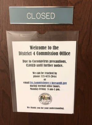 """A sign on the door of Brevard County Commissioner Curt Smith's Viera office indicates that """"due to coronavirus precautions,"""" the office is """"closed until further notice."""""""