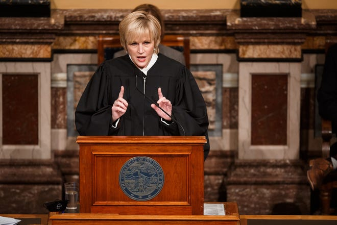 Iowa Supreme Court Chief Justice Susan Christensen delivers her Condition of the Judiciary to a joint session of Iowa's Legislature at the Capitol on Wednesday, Jan. 13, 2021, in Des Moines, IA.