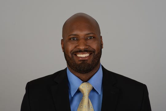 Brad Holmes plays the director of college scouts in the Los Angeles Rams.