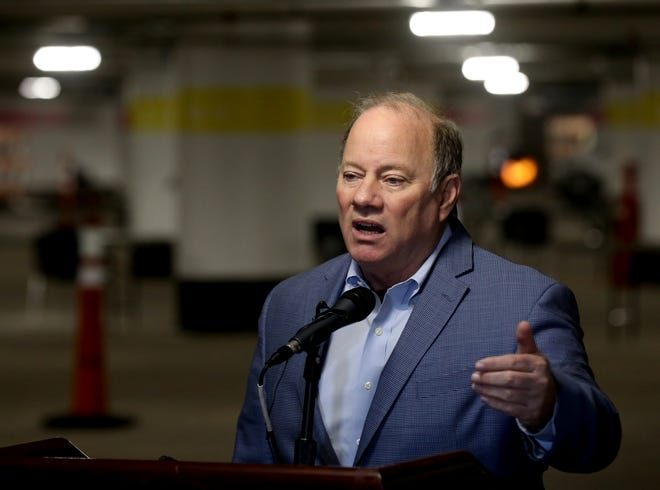 Detroit Mayor Mike Duggan talks with the media in the underground parking lot at the TCF Center in Detroit where the first shots of the Covid-19 vaccine were being given out to people 75 and older behind him on Wednesday, January 13, 2021 Up to 400 vaccines were being distributed in a quick and efficient drive up system. As the days go on more vaccines will be given out.