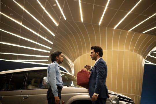 """Adarsh Gourav and Rajkummar Rao in """"The White Tiger."""""""